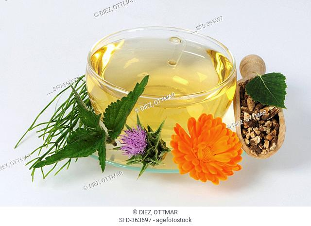 Herbal tea in glass cup and saucer detox tea