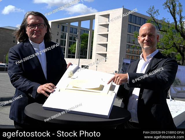 28 May 2020, Berlin: Johannes Milla (l), designer, and Sebastian Letz, architect, show the model at the ground-breaking ceremony for the construction of the...