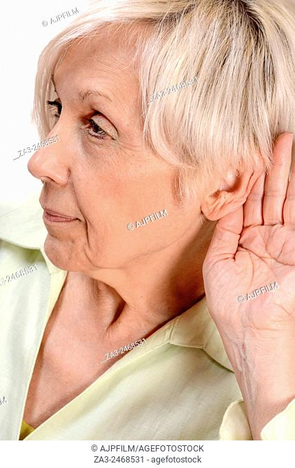 Elderly woman listening