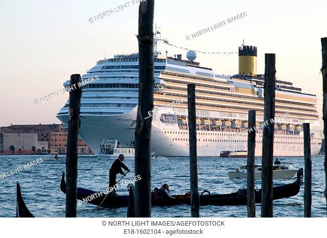 Europe, Italy, Veneto, Venice.  Gondola and cruise ship share the Grand canal