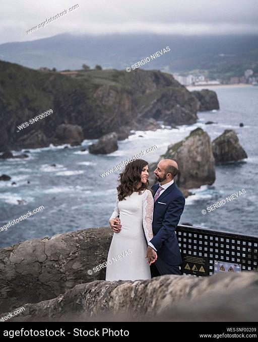 Bridal couple on bridge, Gaztelugatxe, Spain