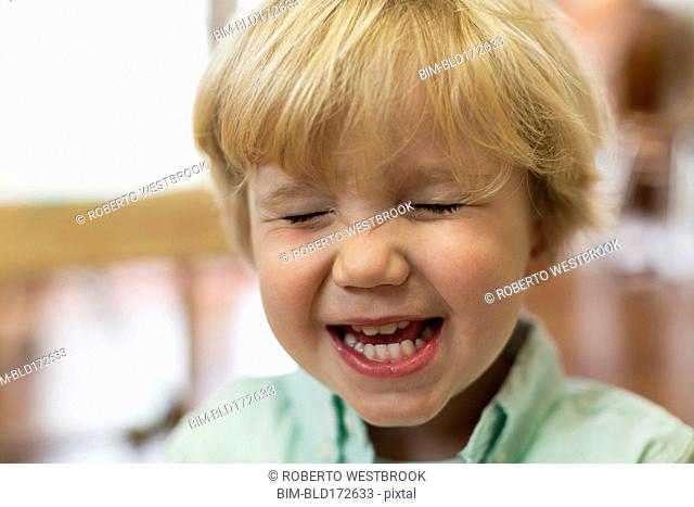 Close up of Caucasian boy laughing