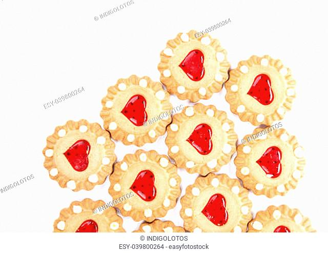 Heart shaped strawberry biscuit. Close up. White background