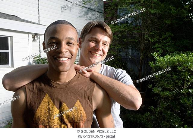 Portrait of two young men, a gay couple, smiling