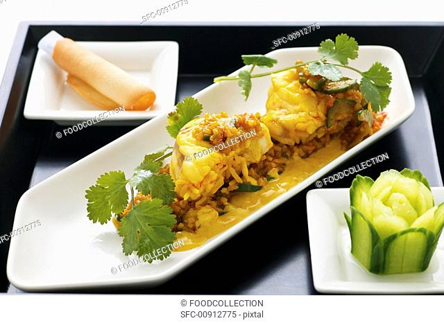 Steamed monk fish with curry sauce, jasmin rice and coriander Asia