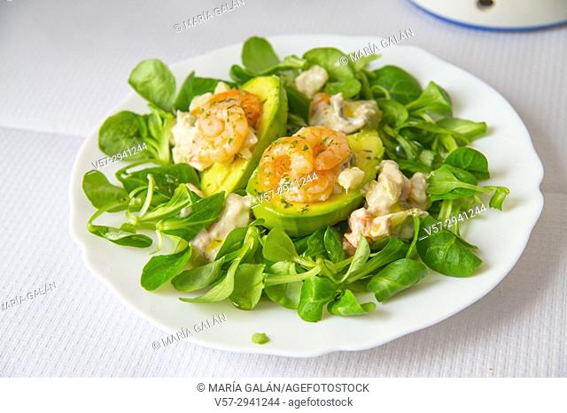Salad made of avocado, prawns and watercress