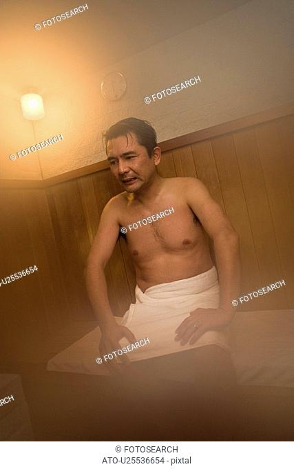 Mature Adult Man Taking a Sauna, Front View, Three Quarter Length