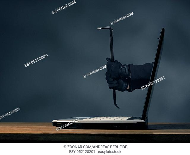 Internet concept image with hands holding a crowbar