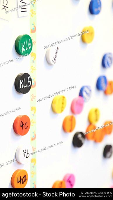 13 February 2020, Berlin: A primary school uses colourful magnets to indicate where the children in the day care centre are currently staying