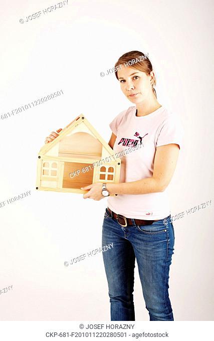 Woman holds a house mock-up  - MR CTK Photo/Josef Horazny