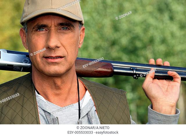 Hunter holding shotgun