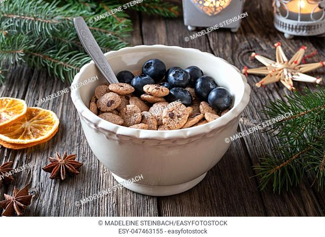Breakfast cereals with blueberries, with spruce branches and Christmas decoration