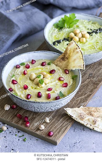 Traditional hummus and avocado hummus in bowls (Arabia)