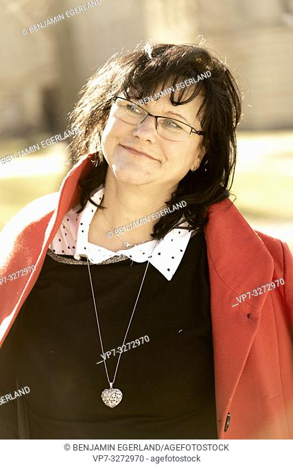 mature woman outdoors in sunlight, in Cottbus, Brandenburg, Germany