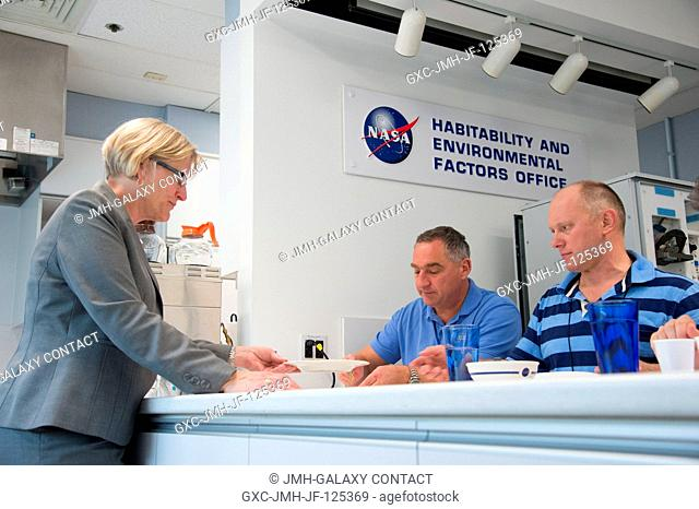 Russian cosmonauts Alexander Skvortsov (left) and Oleg Artemyev, both Expedition 3940 flight engineers, participate in a food tasting session in the...