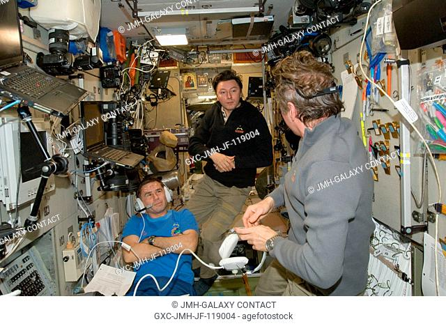 Russian cosmonaut Gennady Padalka (right), Expedition 32 commander; along with cosmonauts Yuri Malenchenko (left) and Sergei Revin, both flight engineers
