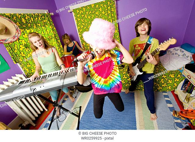 Kids playing instruments in band
