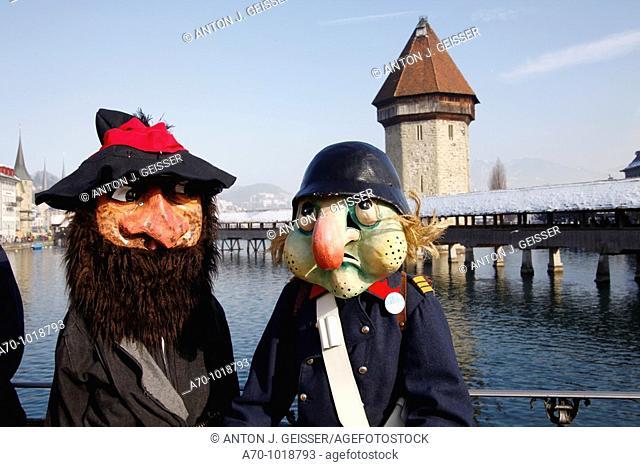 Carnival lucerne switzerland, kapellbrücke in background
