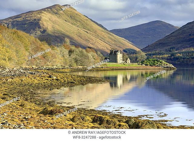 Dunderave Castle in Argyll and Bute, Scotland, reflected in Loch Fyne on an afternoon in late October