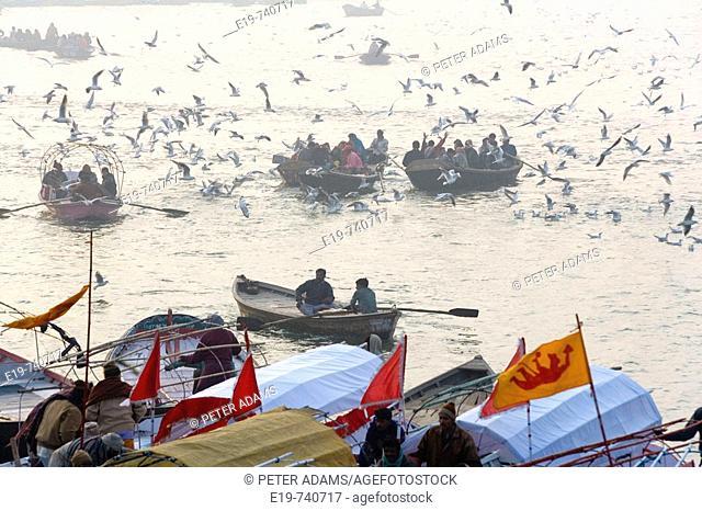 Boats with pilgrims on river Ganges at Kumbh Mela Festival. Allahabad, Uttar Pradesh, India