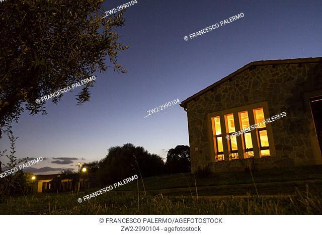 Cozy house in a cold autumn twilight. Bonarcado, Sardinia. Italy