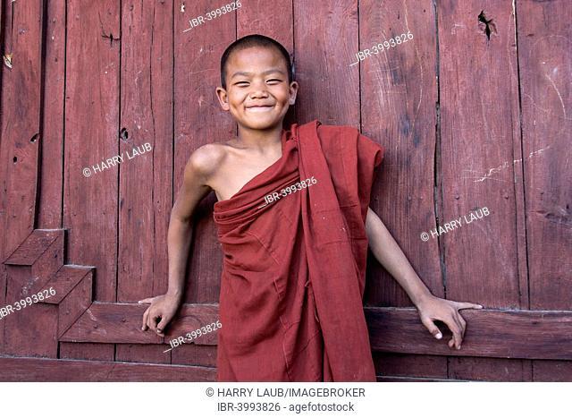 Novice monk in the Shwe Yaunghwe Kyaung Monastery, near Nyaungshwe, Shan State, Inle Lake, Myanmar