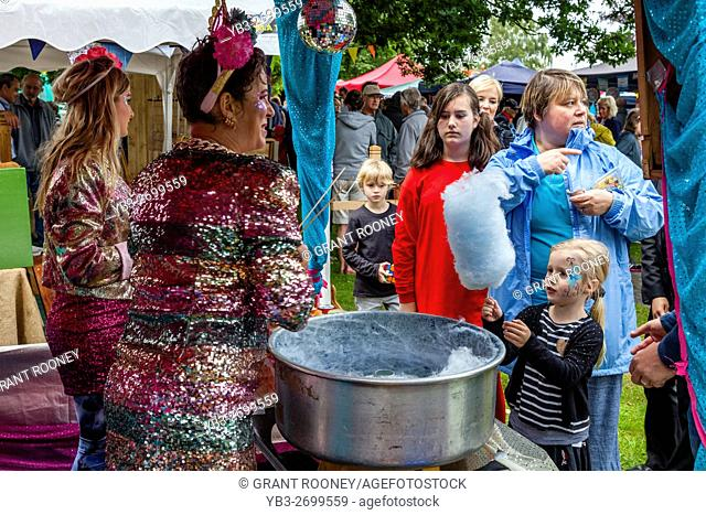 Young Women Selling Candy Floss At The St Lawrence Fair, Hurstpierpoint, Sussex, UK