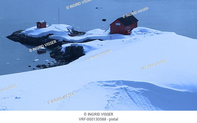 Argentinian Antarctic station hut from high angle, pull out to wider. Almirante Brown. Paradise Bay