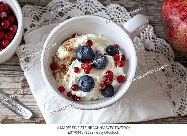 Cottage cheese with ground flax seeds, blueberries, frozen cranberries and currants