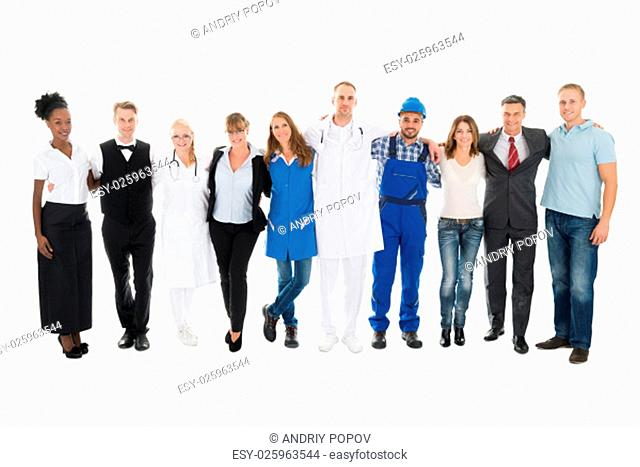 Group portrait of people with various occupations standing together against white background