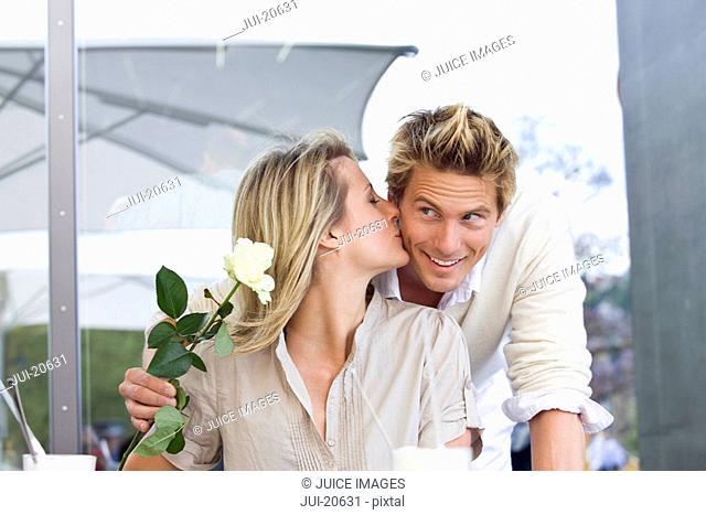 Young couple at an outdoor cafŽ