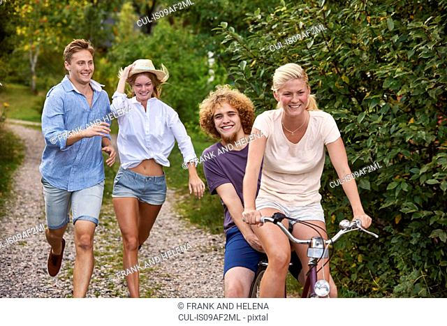 Two young couples chasing each other on bicycle, Gavle, Sweden