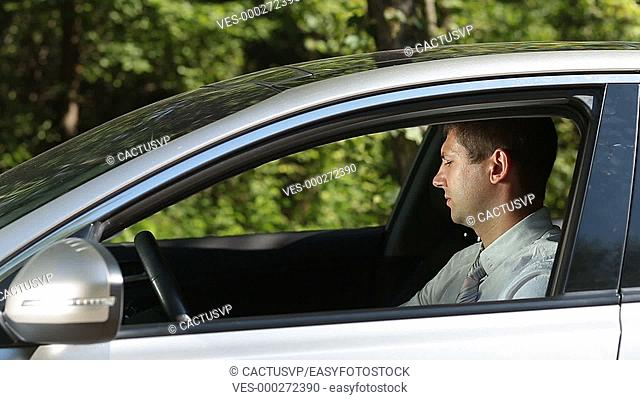 Irresponsible man throwing trash out of car window