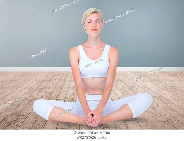 Woman Meditating peaceful yoga in room