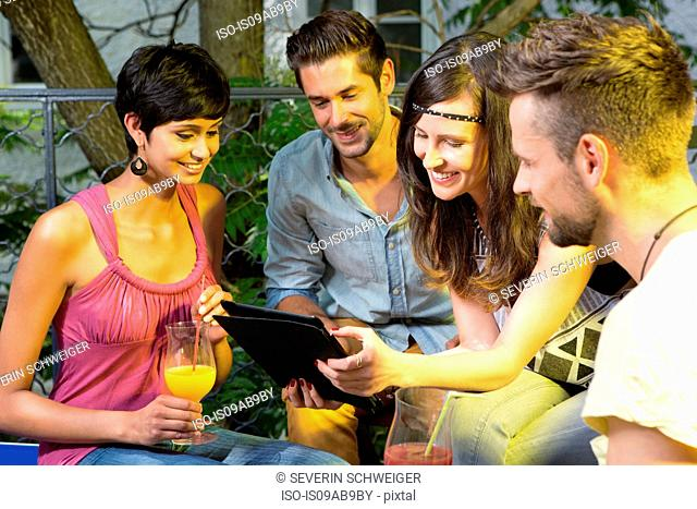 Four friends with digital tablet