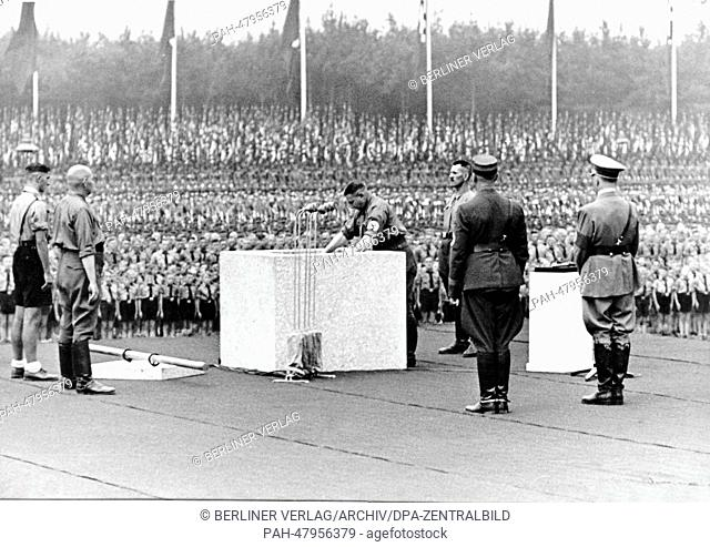 Nuremberg Rally 1937 in Nuremberg, Germany - Nazi party rally grounds - A box with the document is put into the foundation stone in the presence of Adolf Hitler...