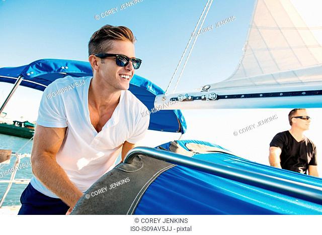 Friends enjoying view on sailboat