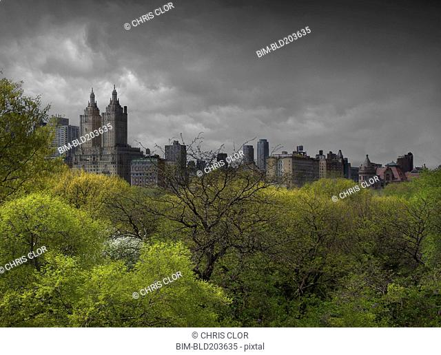 Urban park, skyscrapers and cloudy sky, New York, New York, United States