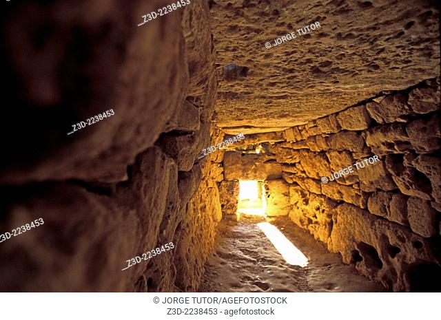 Interior of the Naveta d'Es Tudons, or Naveta of Es Tudons is the most remarkable megalithic chamber tomb in the Balearic island of Minorca, Spain