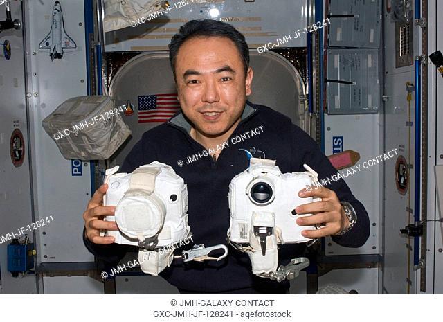 Japan Aerospace Exploration Agency astronaut Satoshi Furukawa, Expedition 28 flight engineer, poses for a photo while holding extravehicular activities (EVA)...