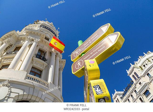View of sign and Metropolis Building on Gran Via, Madrid, Spain, Europe