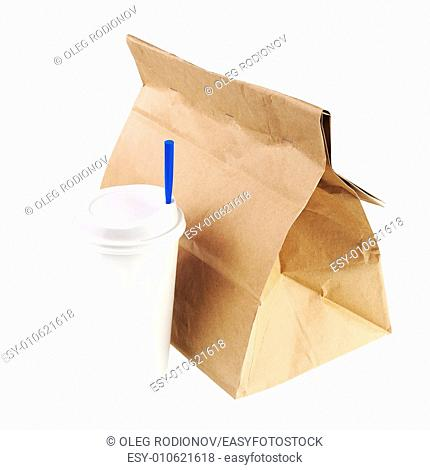 Lunch brown recycle paper bag and cup of coffee or tea with blue tube for drinking isolated on white background. Side view