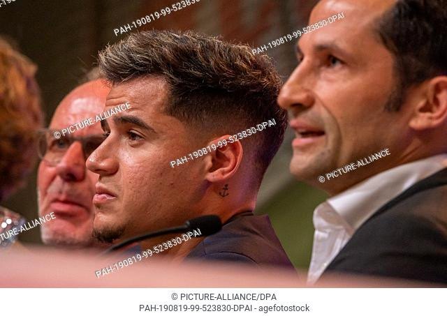 19 August 2019, Bavaria, Munich: Karl-Heinz Rummenigge (l-r), CEO of FC Bayern Munich, Philippe Coutinho and Hasan Salihamidzic, Sports Director
