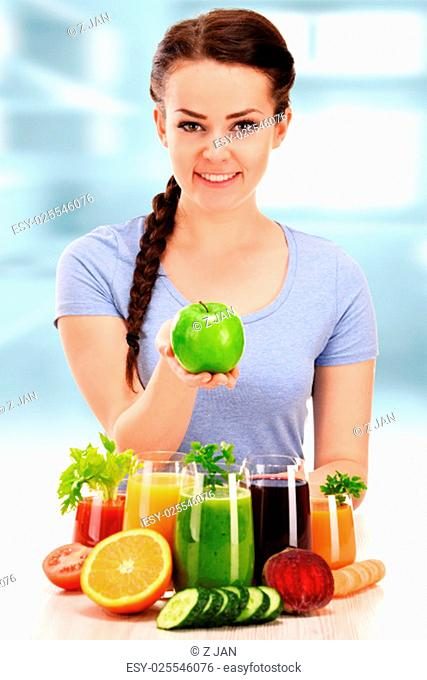 Young woman with variety of vegetable and fruit juices. Detox diet