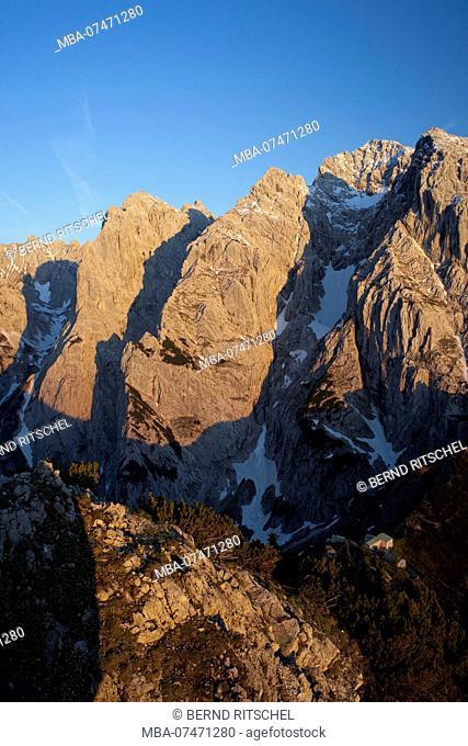 View of Fleischbank and Kaiser north face from Stripsenkopf at sunset, Wilder Kaiser, Tyrol, Austria