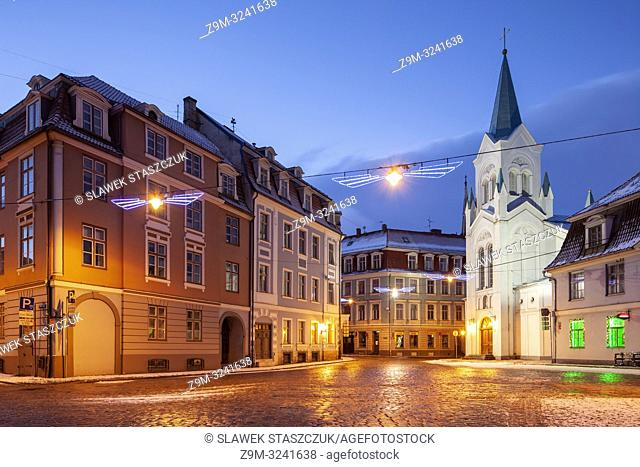 Winter dawn at Our Lady of Sorrow church in Riga old town, Latvia