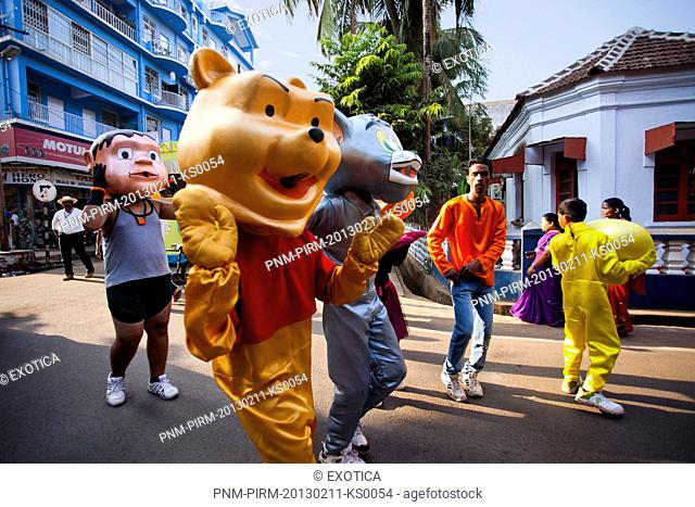 People in costume of cartoon characters during a procession in a carnival, Goa Carnivals, Goa, India
