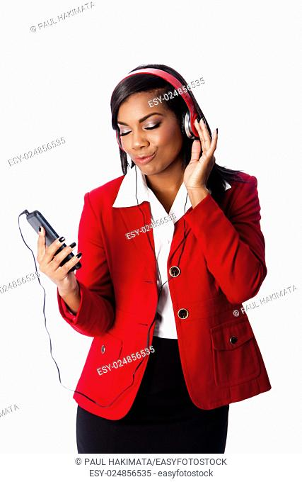 Beautiful happy business woman jamming listening to music on wireless mobile phone, on white