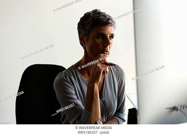 Mature businesswoman looking at computer