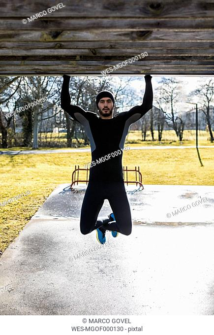 Spain, Gijon, athlete exercising in park